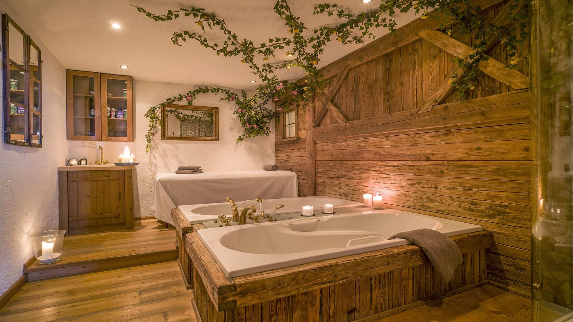 Two tubs with candlelight in wood-panelled room
