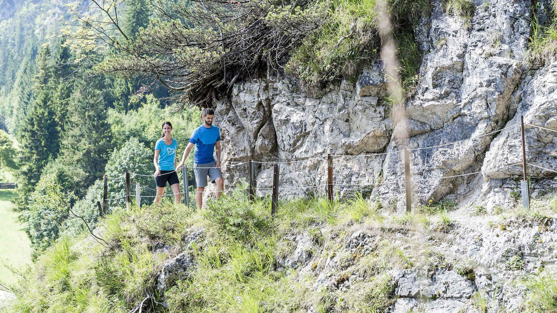 Couple hiking on summer holidays in Tyrol