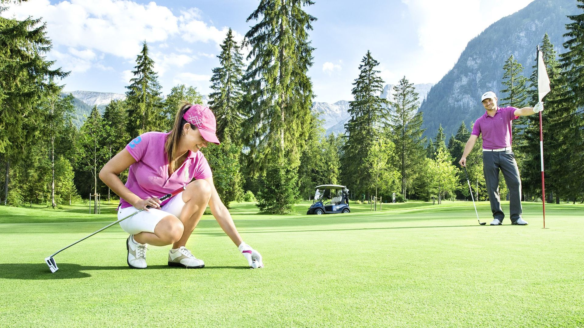 Couple golfing on an adventure holiday in Austria during summer